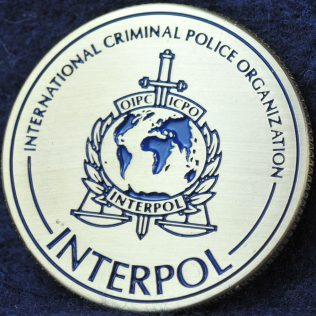 INTERPOL 100 years of International Police Cooperation Gold