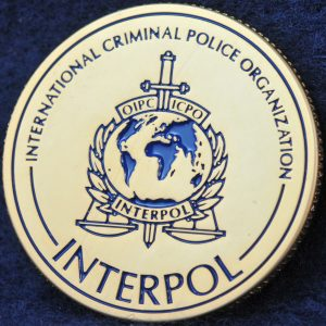 INTERPOL 100 years of International Police Cooperation Gold 2